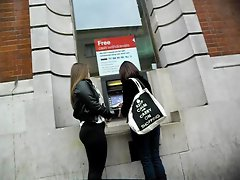 Sizzling teen girl with big butt at cashpoint