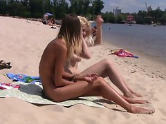 Sizzling teen nudists get naked and heat up a public beach