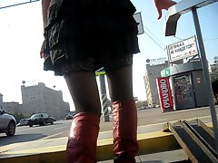 Young lady in black stockings & red high boots going upstairs 1
