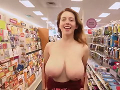Red-haired Flashes Enormous boobs in Store