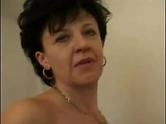 Mature brunette fucks