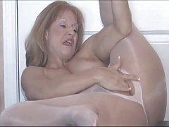 Mature Slutty Sammi has fun in her pale pink pantyhose (TheNylonChannel)