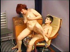Redhead mature pleases a teen