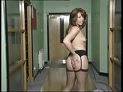 Milf takes off a suit and dildoes herself in corridor