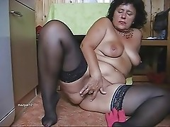 Chubby mature in black stockings