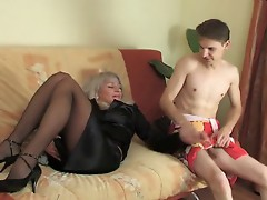 mature in stockings seduces young guy