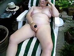 Big titted Mature slut masturbates outdoor
