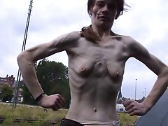 a skinny mature woman with small empty saggy tits