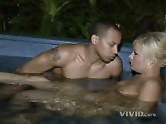 Erica Lynne shows off her ass and then sucks cock in pool