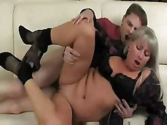 Granny gets young boy to fuck her and eat her on the couch
