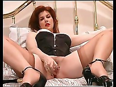 Sexy MILF in a corset uses a dildo and masturbates on webcam
