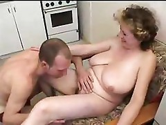Busty mom gets a group orgy going and sucks and fucks the boys