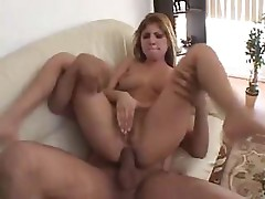 Sativa Rose gags on cock and then takes it in her tight ass