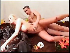 Big-tittied blondie gets her hole plowed by a well-endowed dude