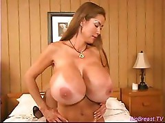 This girl has some monster boobs as these two lesbians get it on