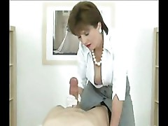 Mature, sexy British MILF is giving a nice blowjob on webcam