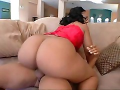 Busty big ebony spreads her legs on the couch and fucks on the floor