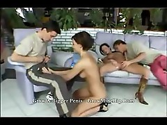 Two babes and two dudes are in a group fuck in this foursome