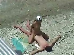 Nude couple on the beach have some hot and sweaty fucking