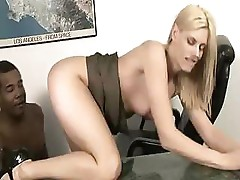 Mature blonde sucks on a black cock and gets fucked on the table
