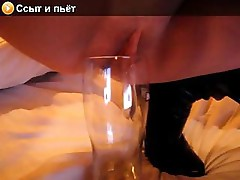 Naughty masked webcam model fills glass with her urine and drinks it