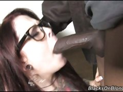 Nerdy Misti Dawn filling her mouth with black cock