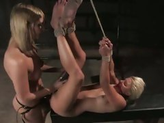 This tied up whore gets her twat tormented