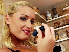 Kathia Nobili hot blonde licking a blue dildo