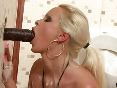 Busty blonde sucking off black cock to messy facial