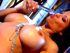 Alexis Amore sucking a crystal clear dildo