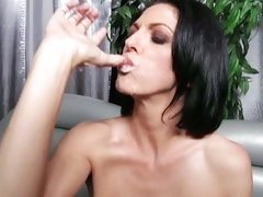Roxanne Hall licking her fingers with cum