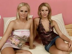 Tara Pink with her naughty friend sitting on bed