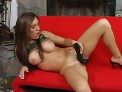 Jaclyn Case in sexy army suit dildoing in the sofa