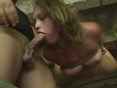Kathia Nobili tied and hung on a rope doing oral