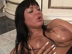 Busty slut working onto a huge rubber toy