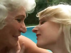 Busty granny appreciates lesbie porn with blonde