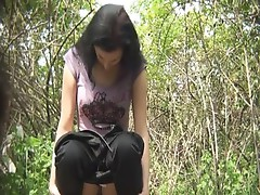 Unshaved brunette pissing inside the forest