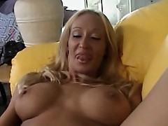 Busty horny mom toys involving her pussy