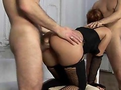 Venereal nymphet in stockings gets got laid by couple giant dicks onto the sofa
