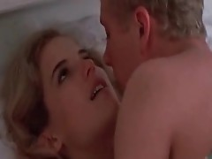 Kelly Preston rEmoving her bra to reveal her Nice Meatballs, which a guy touches. we then See her take off her panties and give us a look at her ass a