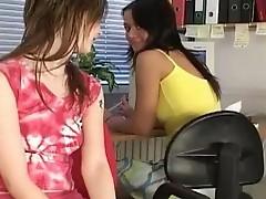 Two girls fucking inside an office chair