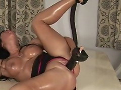 Busty Horny doxy working on a huge fake penis