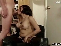 Asian tranny loves eating young man's cock