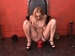 Kinky blonde gal Kelly Wells riding huge red dildo