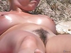 Voyeur spies on trimmed pussy at nudist beach