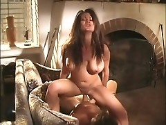 Busty brunette lady rides big throbbing shaft