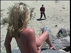 Briana Banks masturbates clit and squirts on a rock