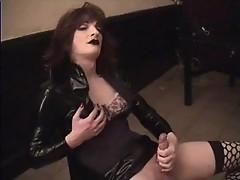 Heavy makeup tranny Cassy stroking hard cock