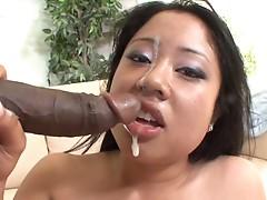 Kya Tropic slurps up a big black cock and gets her just reward