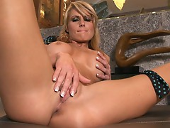 Sexy Randy Moore loves tormenting her juicy moist clit